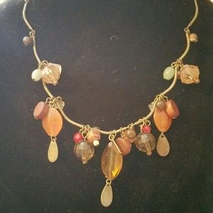 Multi color bleeding on an antique look bronze cha